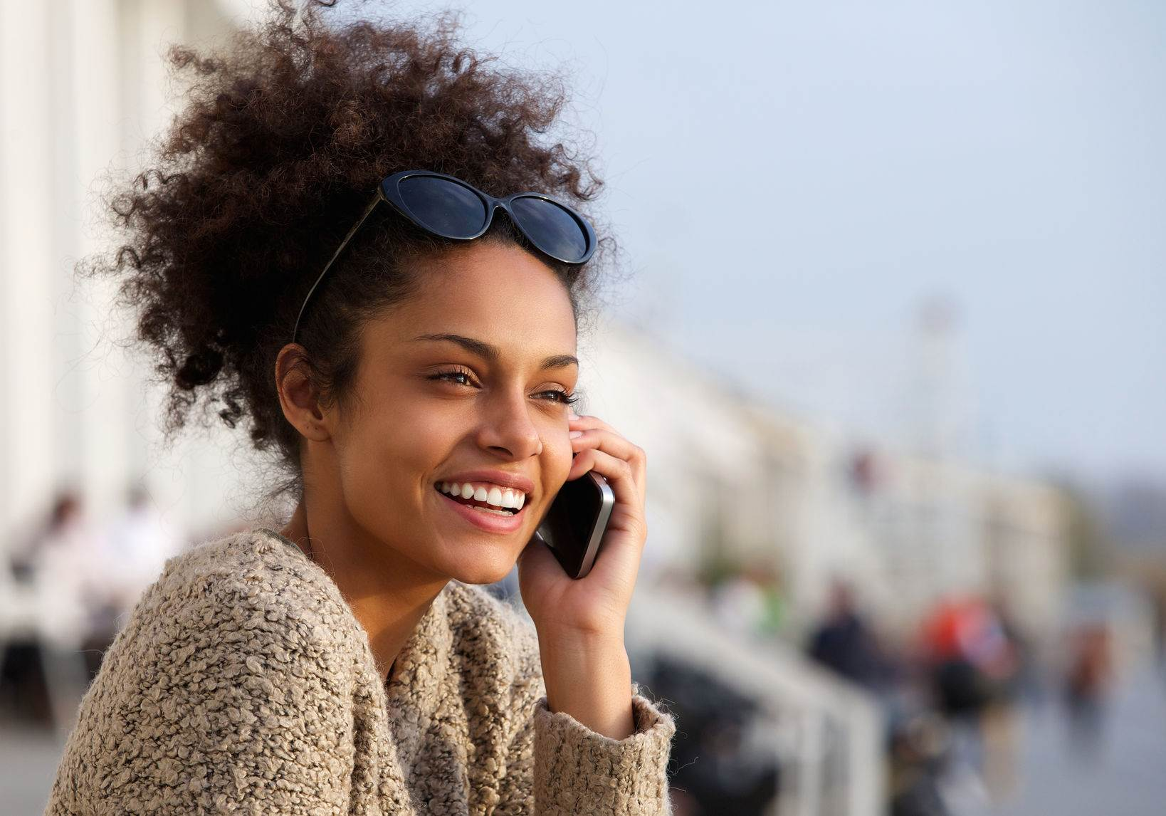 40345571 - close up portrait of an attractive young woman smiling and talking on mobile phone